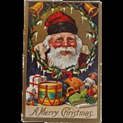 1909 Christmas Postcard Santa Toys Wreath Bells Free shipping to Canada & USA
