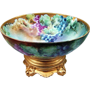 """Magnificent T & V Limoges France 1915 Hand Painted """"Red, Purple, Green, & Yellow Grapes"""" 14"""" Majestic Pedestal Fruit Center Bowl by the Listed Artist, """"E.W. Bieg"""""""