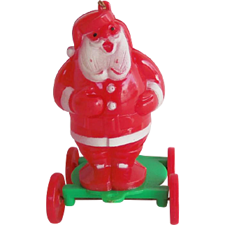 Vintage Rosbro Hard Plastic Christmas SANTA Candy Holder Pull Toy on Rolling Cart
