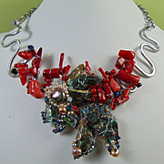 Fish in the Coral Mixed Metals Necklace.