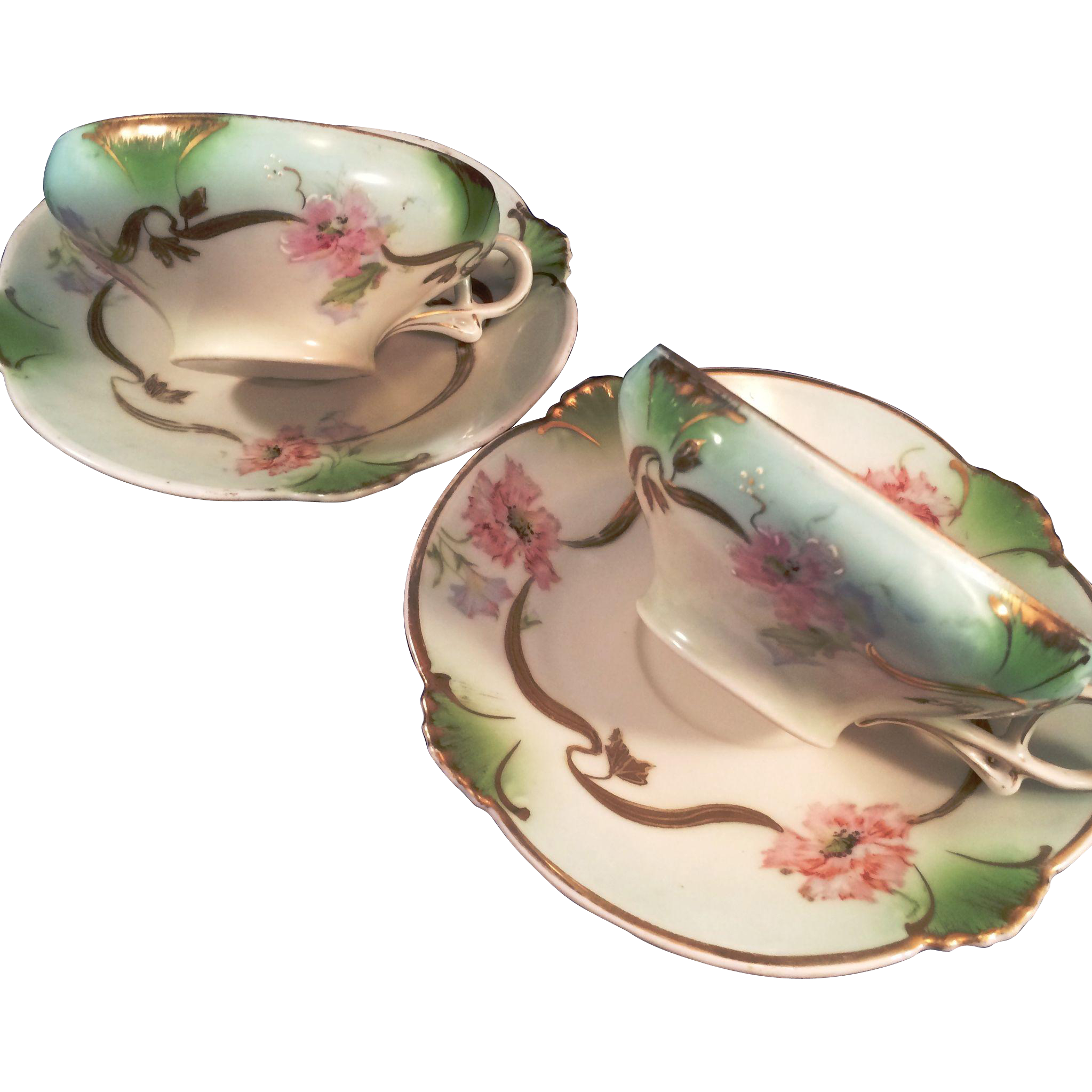 2 Hand decorated Bavarian porcelain Cups and Saucers  floral pattern