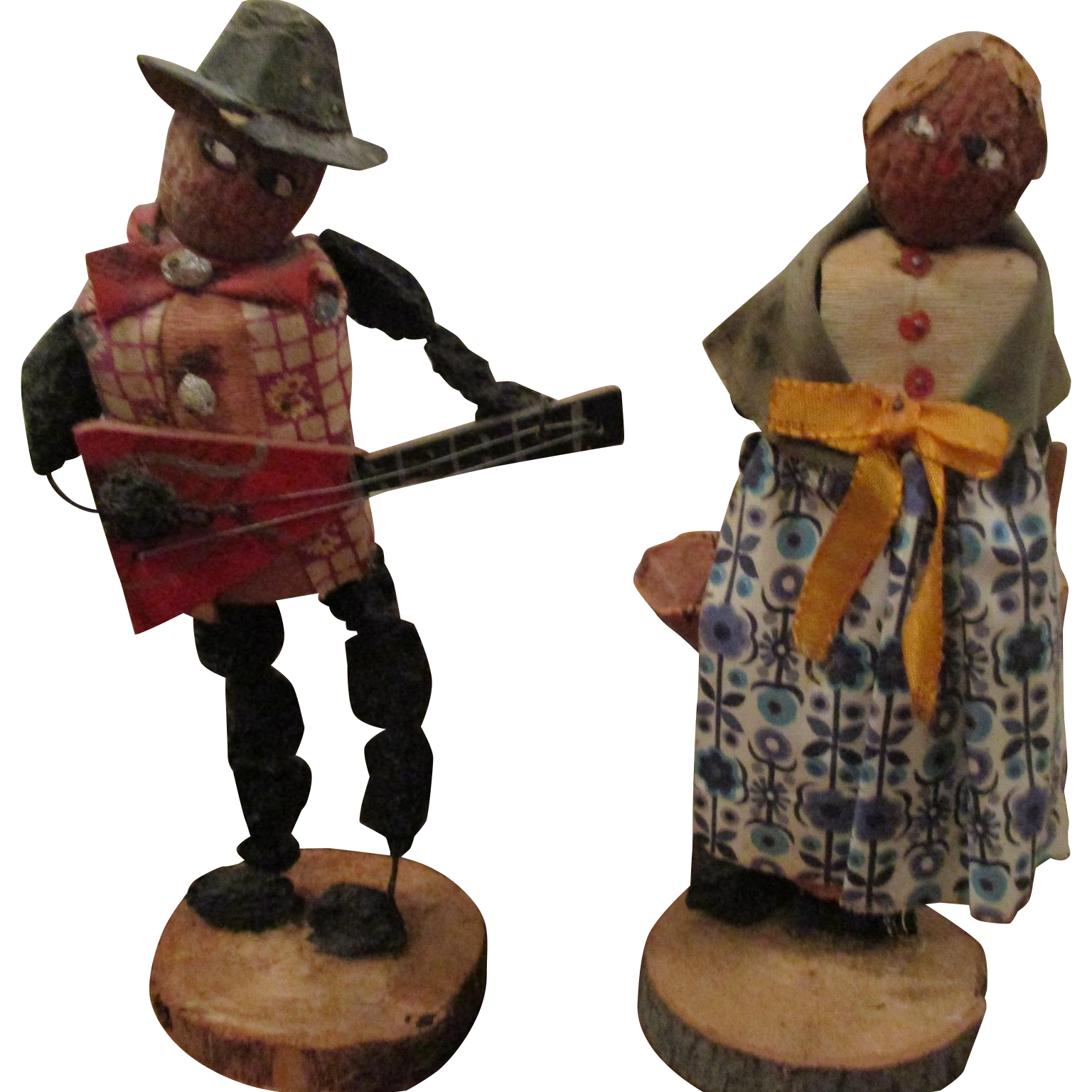 Folk Art Walnut Dolls