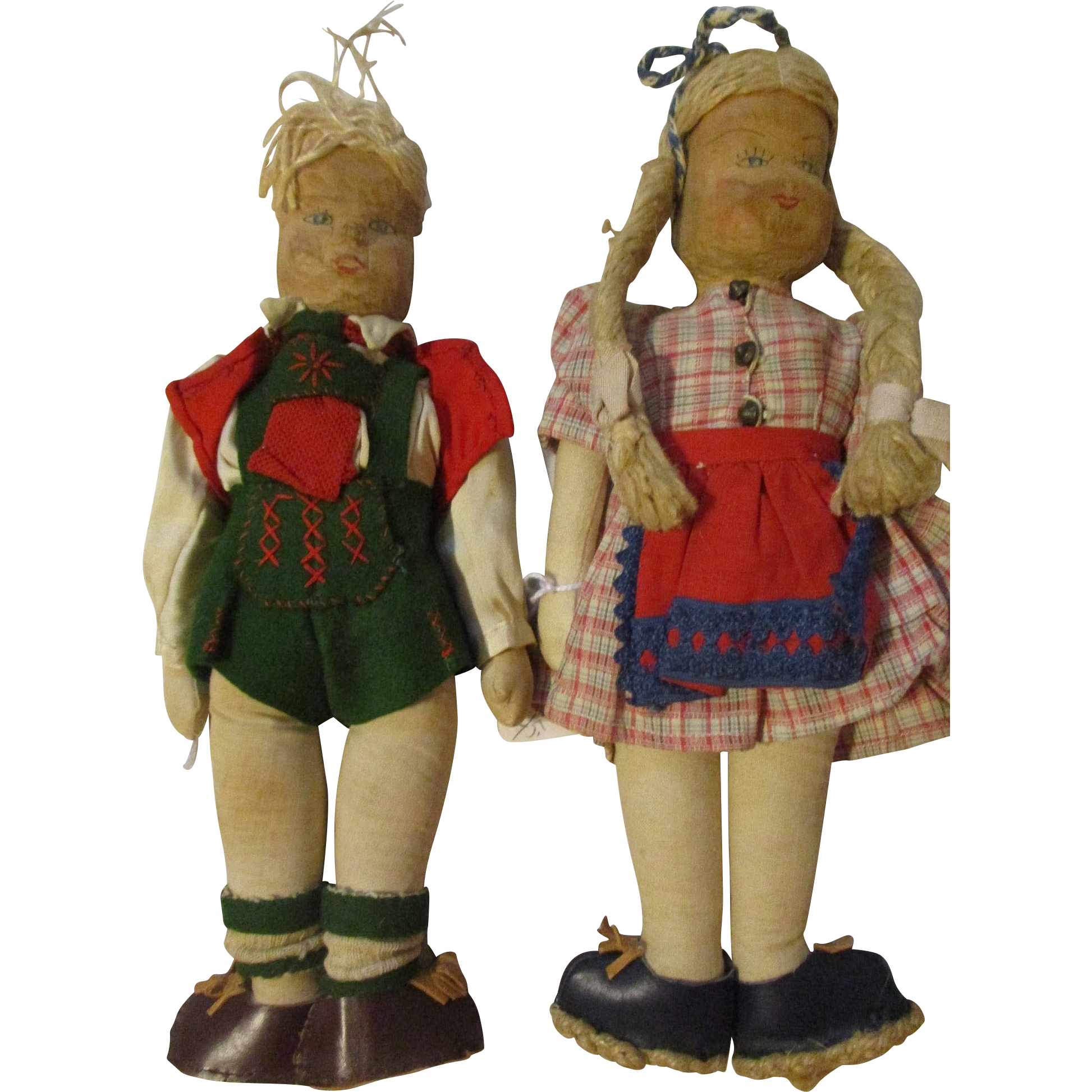 "10.5"" Pair of Wooden Carved Dolls"