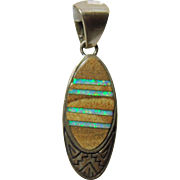 Calvin Begay Oval Pendant with Inlay of Opal and Agate