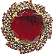 Large Brooch with a Round Bright Red Rhinestone Surrounded by Iridescent Rhinestones