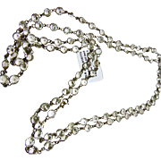 1920s White Metal Necklace of Round Open Back Crystals