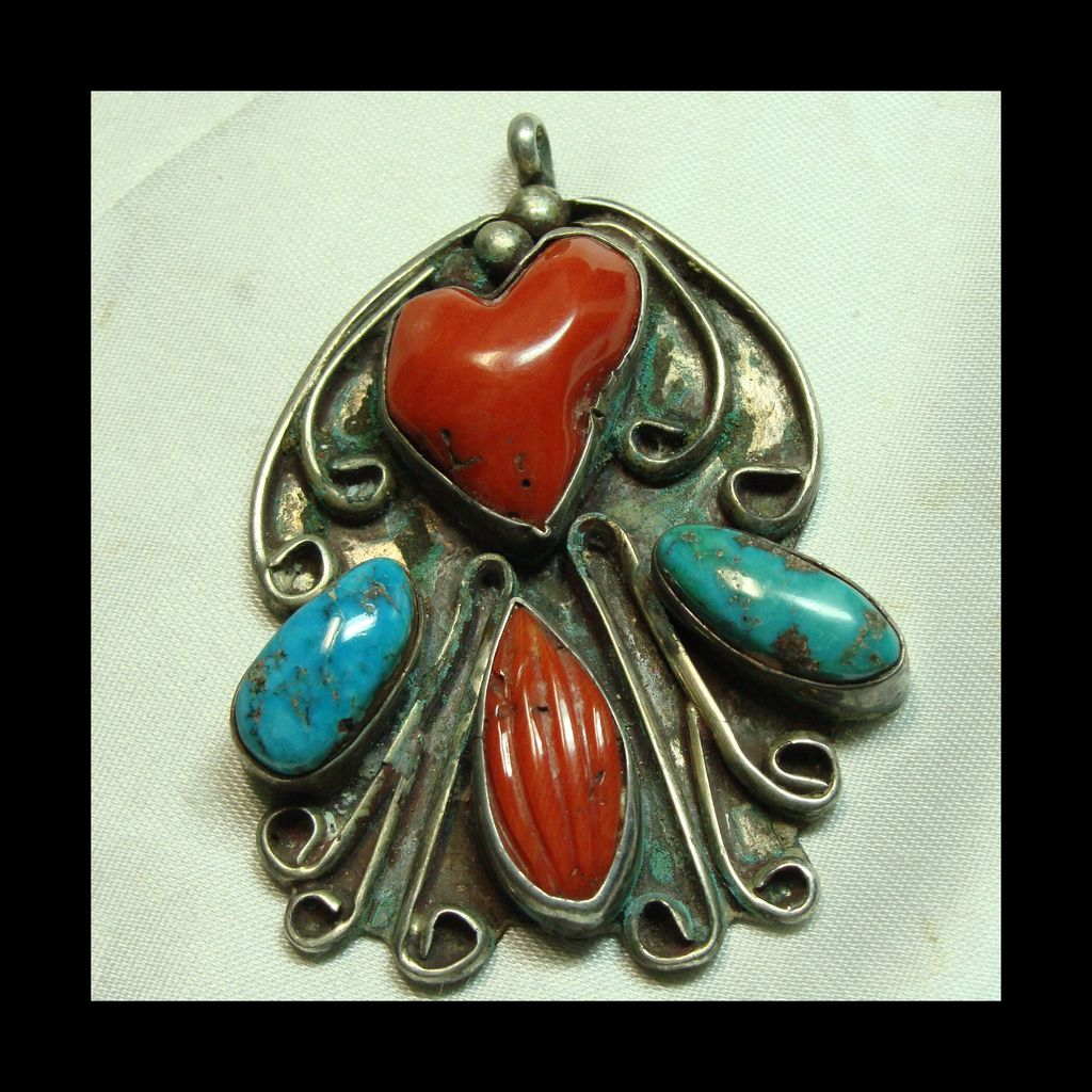 Sterling Silver Pendant with Turquoise and Carved Red Coral