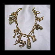 Early 1970s Palm Springs Gold Filled and Sterling Charm Bracelet