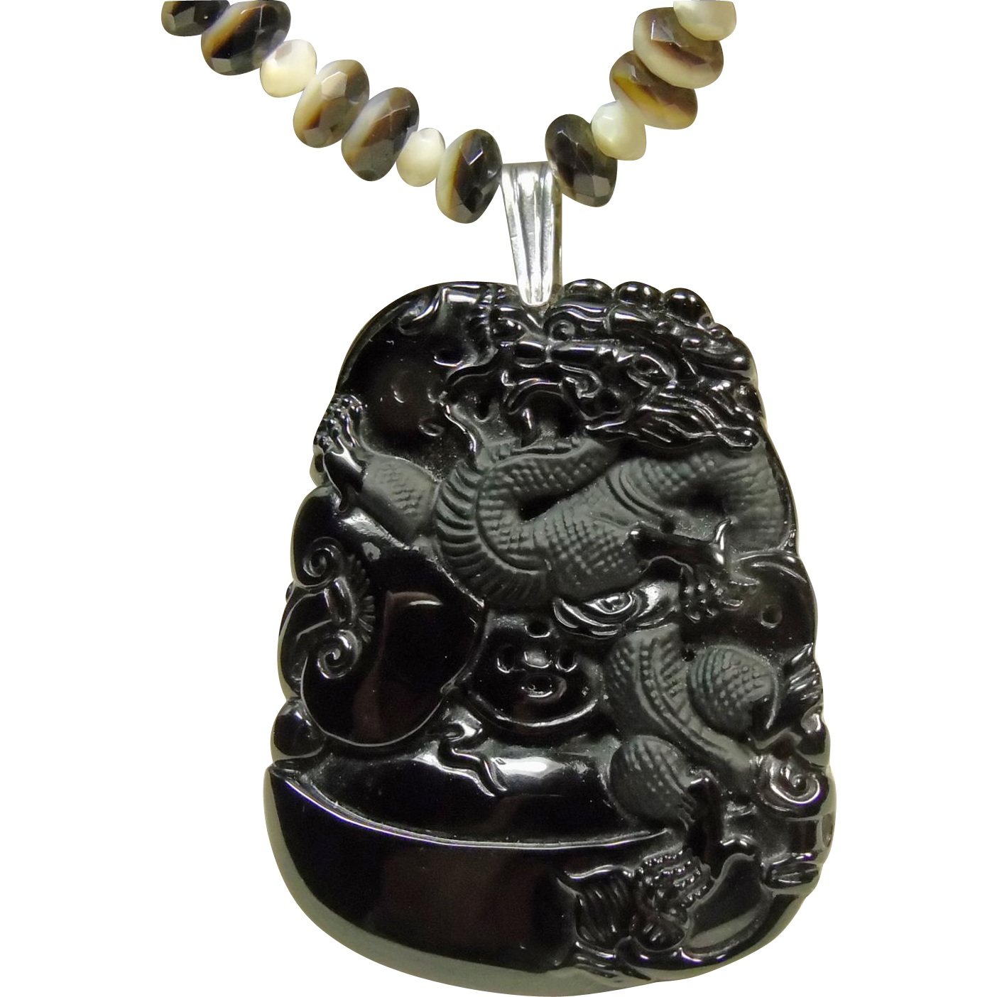 carved black obsidian pendant on a necklace of