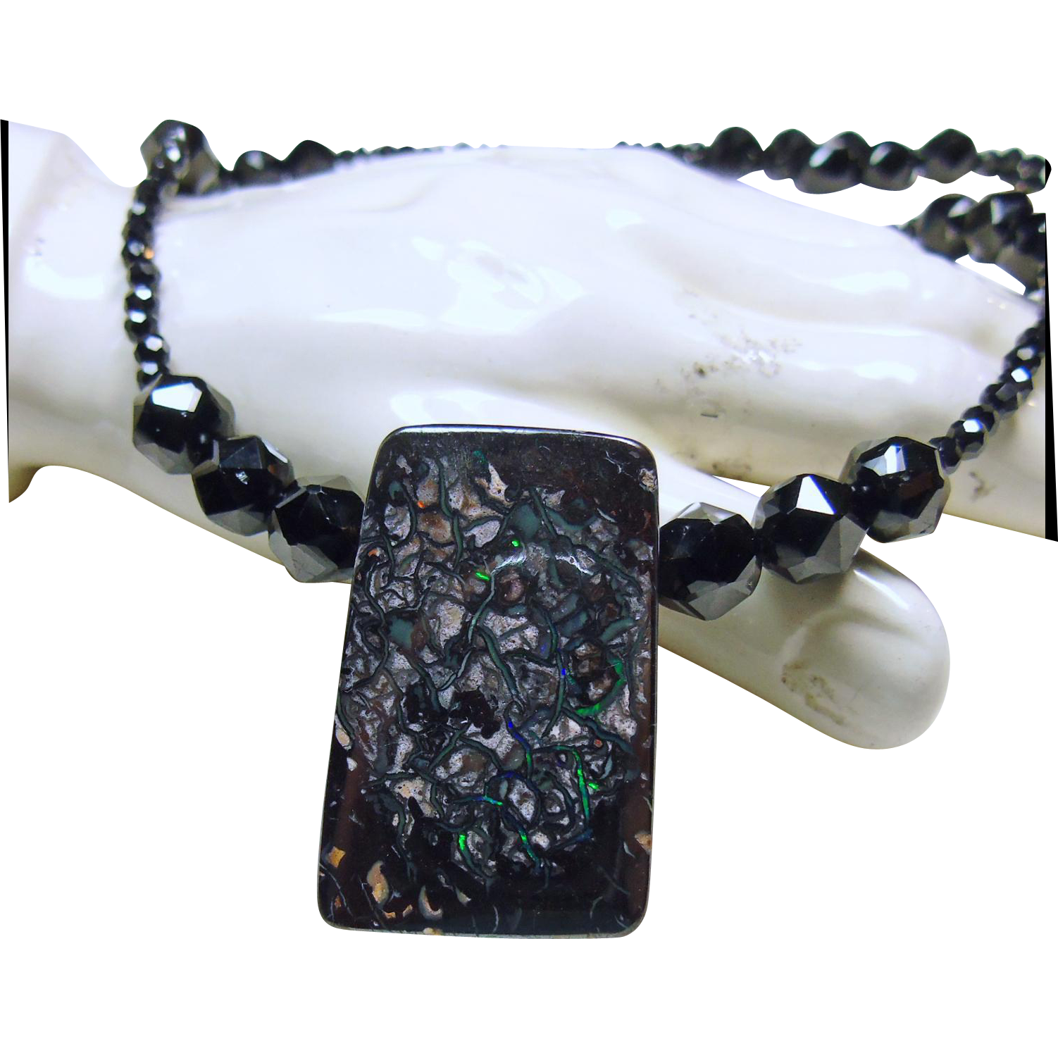 Necklace of black spinel with boulder opal pendant from for Jewelry stores boulder co