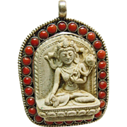 Tibetan Handmade Sterling Silver Pendant with Carving of Buddha Surrounded by Red Coral Beads