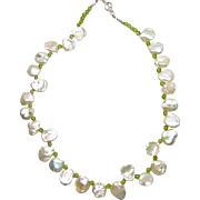 Necklace of Creamy Keishi Pearls with Peridot Bead Accents