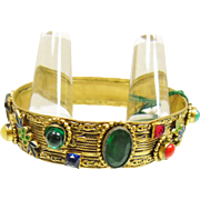 Gold Over Brass Embossed Bangle Bracelet with Multiple Color Rhinestones and Cabochons