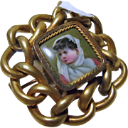 Enamel on Metal Picture of a Young Child in Brass Setting