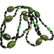 Stunning Black and Green Glass Necklace with Green Molded Iridescent beads