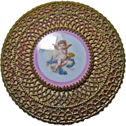 Gilded Brass Cranberry Dresser Box with Porcelain Plaque of a Cherub