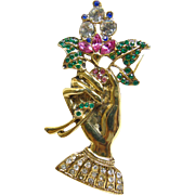 Brooch in the Shape of an Hand Holding Rhinestone Flowers