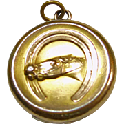 Round Locket Decorated with Head of a Horse Peering Out of Horseshoe