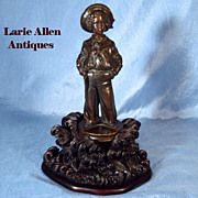 Reserved for K   Antique French bronze sailor boy on carved black forest base