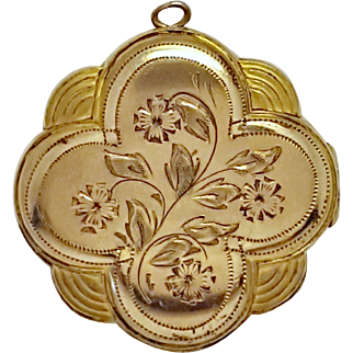 Gold Plated 4 Leaf Clover Locket with Round Photo Pockets and Floral Motiffs