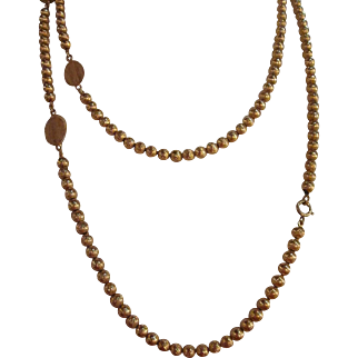 """Vintage extra long gold tone with round  beads and Flat beads - 50"""" Signed Trifari necklace"""