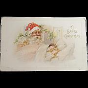 A Happy Christmas Santa Looking Over Sleeping Children Postcard 1912