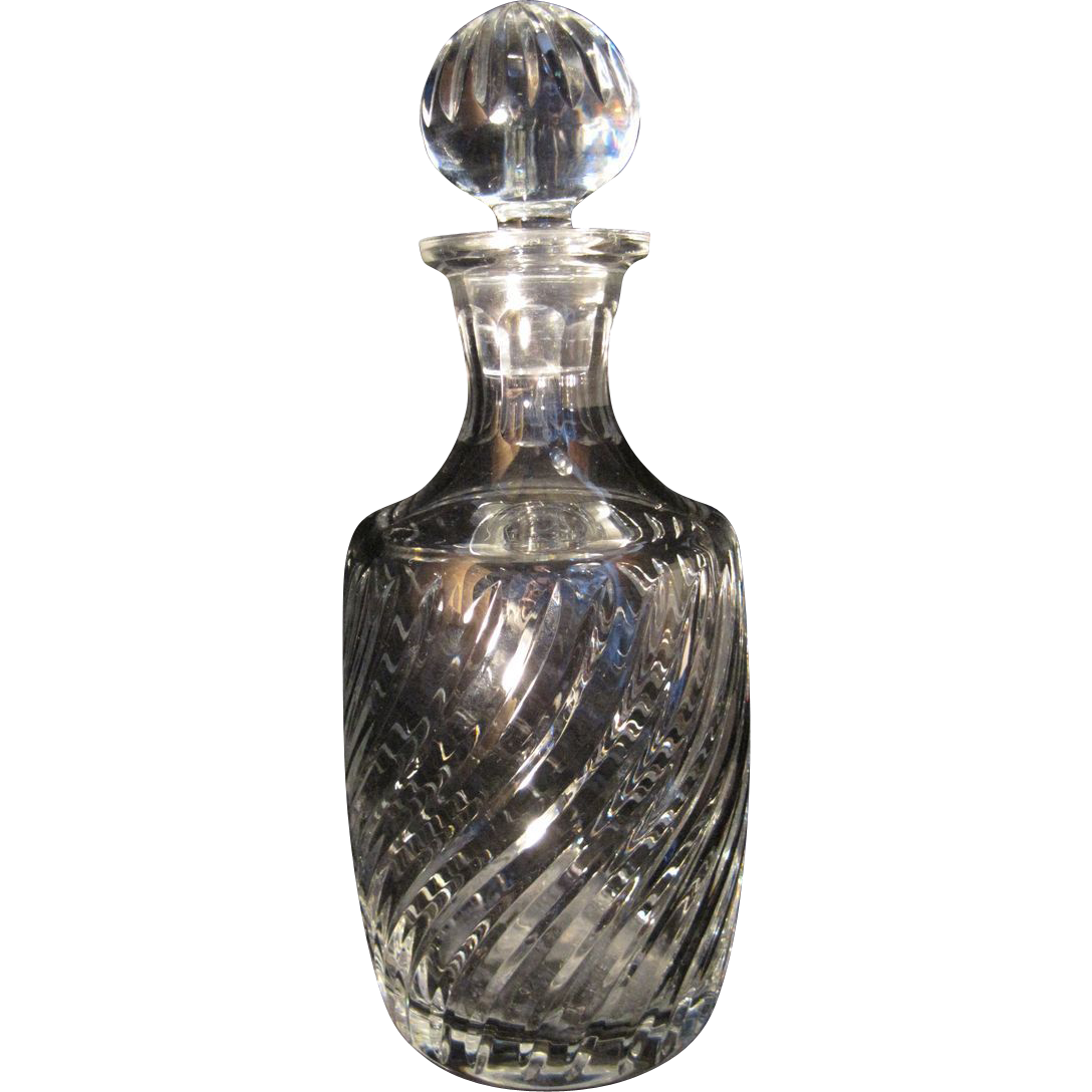 cut crystal decanter with swirl pattern and ridged stopper 1 of 2