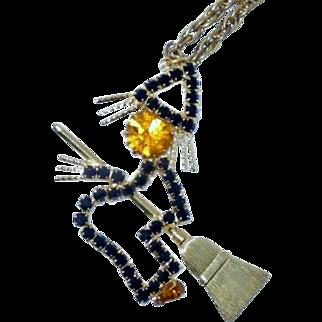Vintage Rhinestone Halloween Witch on Broom Necklace black orange jewelry