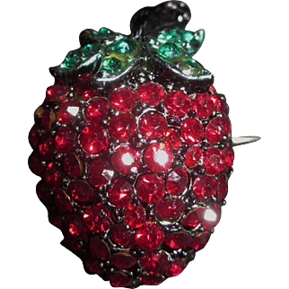 Vintage Red and Green Rhinestone strawberry brooch in black japanned metal