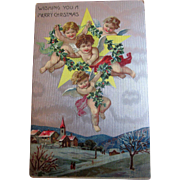 Vintage German Christmas Postcard with beautiful floating cherubs surrounding a star with garland and bows