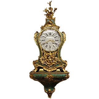 Green horn cartel clock is from period 1747 (Louis XV).
