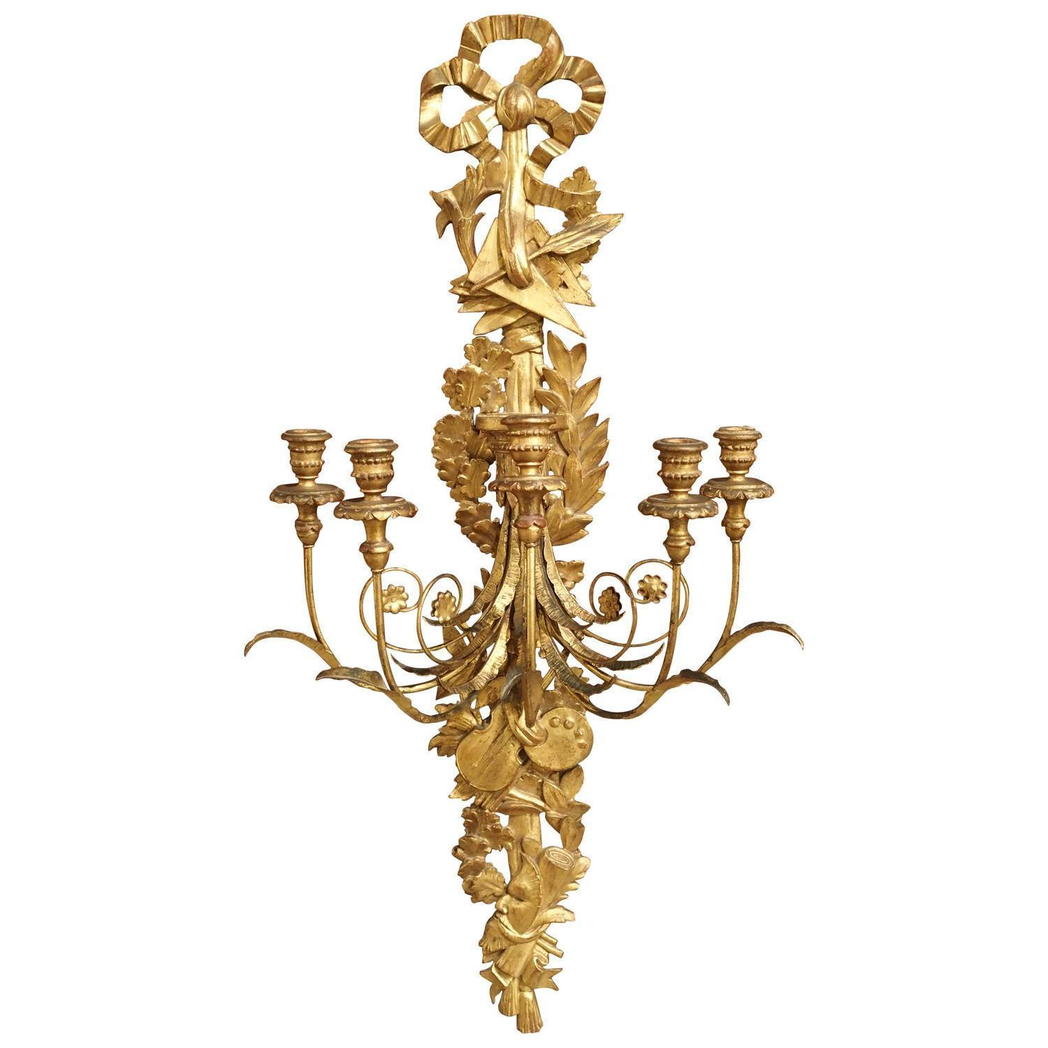 Italian Giltwood and Gilded Wrought Iron Five-Light Trophy Sconce