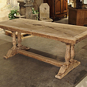 An Early 1900s Bleached Oak French Dining Table