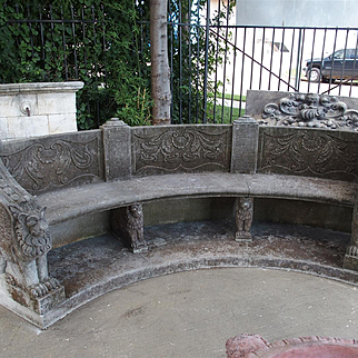 A Large Semi Circular Carved Limestone Griffins Bench