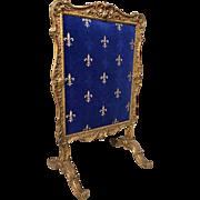 Sculpted Antique Wooden Firescreen from France with Fleur De Lys Velvet
