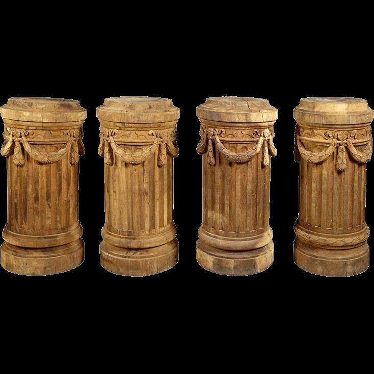 A Set of Four Antique Oak Column Pedestals from France