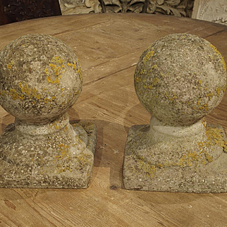 A Pair of Round Reconstituted Stone Finials from France