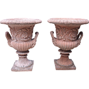 Pair of French Terra Cotta Colored Cast Stone Urns