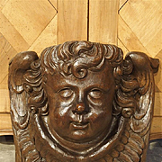 A Large 17th Century Flemish Carving of a Winged Cherub