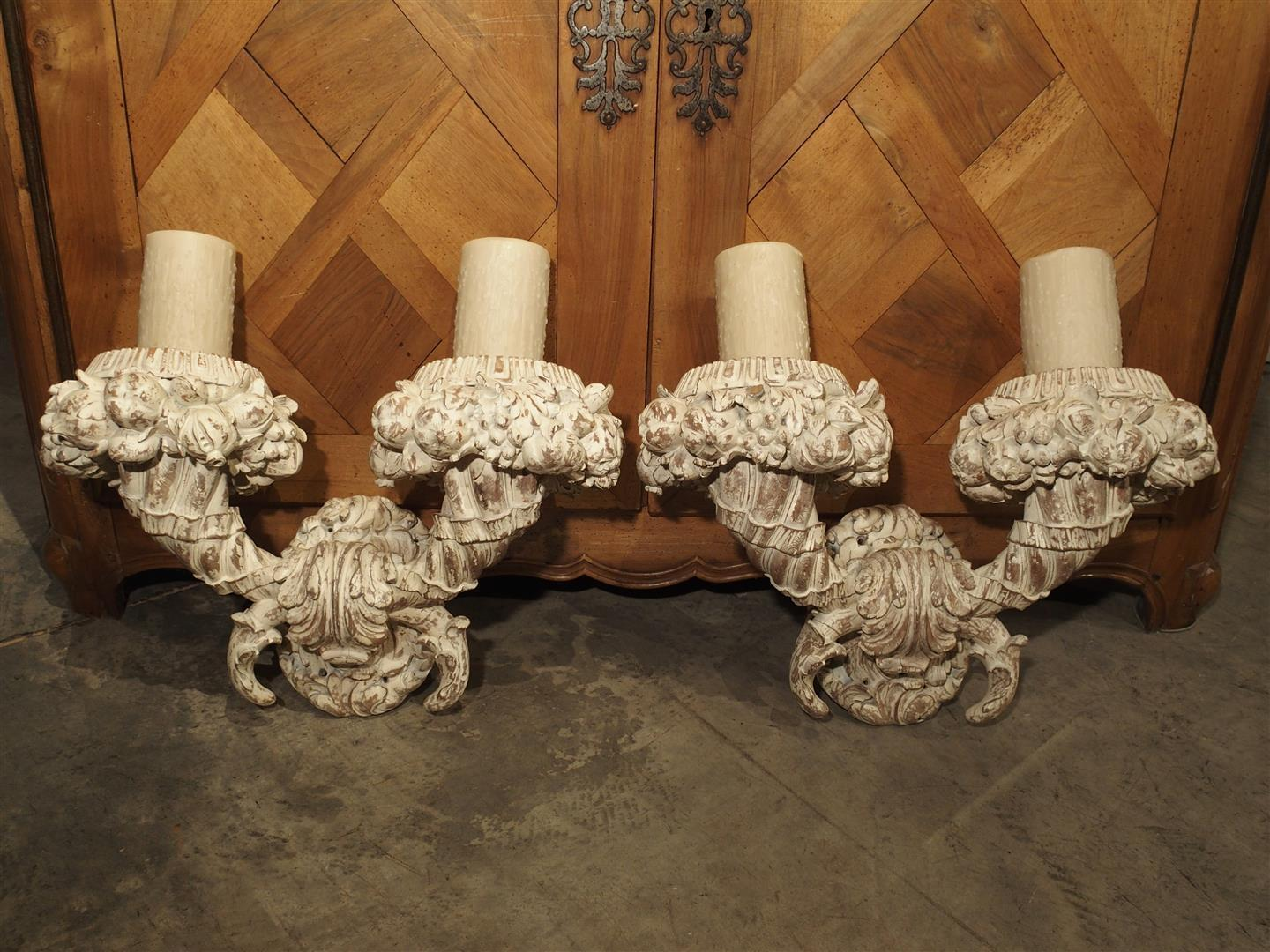 Pair of Large Carved and Parcel Painted Wooden Sconces