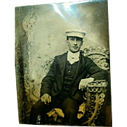 1890s Tintype handsome young man seated ornate wicker chair & painted backdrop