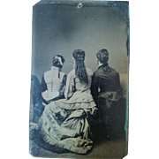 Rare tintype circa 1880s trio of young women facing backwards to show hairstyles Victorian fashion