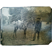 Wonderful outdoor tintype occupational farmhand with skinny horse saddle & house circa late 1800's