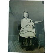 Tintype portrait 1870's long haired young girl holding porcelain head Jenny Lind doll