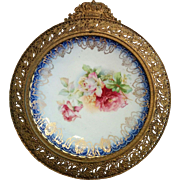Ornate circular metal frame with pottery rose plate circa earlier 1900's wonderful display