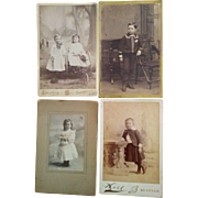 Four darling cabinet card photographs of children young boys wearing dresses girl in cart New York Iowa