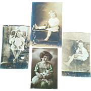 Four vintage circa 1920's 30's photographs of young girls one holding white cat