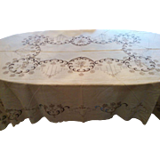 Ornately hand embroidered linen tablecloth with a flower and berry or grape motif