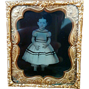 Framed tintype Mid 1800's ghostly child dressed in white gown with black stripe trim