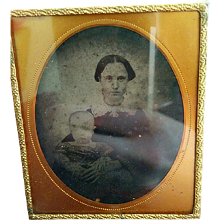 Uncased Victorian ambrotype young woman mother with infant late circa 1850's early 1860's